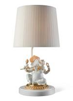 Lámpara de mesa de porcelana – Ganesha con bansuri. Lustre oro – Lladró